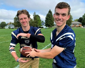 Delhi Raiders running back Tre Hodder, left, and Raiders quarterback Adam Leatherland accounted for four touchdowns in Delhi's 35-20 win over the Waterford Wolves in Delhi Friday. The win raises Delhi's record to a league-leading 3-0 while the Wolves fall to 0-2. – Monte Sonnenberg