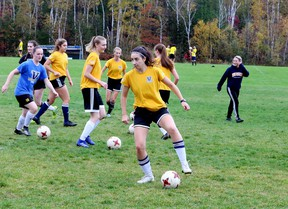 Amanda Cuthbert, foreground, practises with teammates from the Laurentian Voyageurs women's soccer team at Laurentian University in Sudbury, Ontario on Tuesday, October 12, 2021.