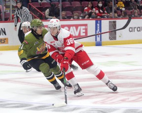 Jordan D'Intino of the Soo Greyhounds rags the puck as North Bay Battalion forward Liam Arnsby tracks from behind. Rory Kerins scored a hat-trick as the Hounds picked up an 8-5 win over the Battalion in Ontario Hockey League action at the GFL Memorial Gardens on Friday night.