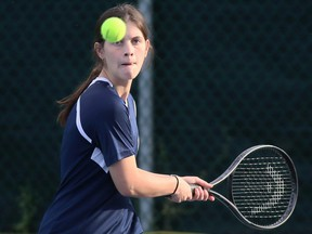 Lindsay St. Germain of Chatham-Kent hits a return during the mixed doubles final at the LKSSAA South tennis tournament at the Chatham Tennis Club in Chatham, Ont., on Tuesday, Oct. 12, 2021. Mark Malone/Chatham Daily News/Postmedia Network