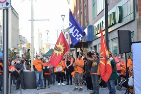 Hundreds of Londoners gather Thursday evening on Dundas Place for the Turtle Island Healing Walk. The event to mark the National Day for Truth and Reconciliation included speeches and a pop-up market. (CALVI LEON, The London Free Press)