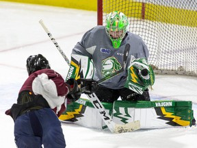 London Knights goalie Mathias Onuska makes a save against Knights prospect Mike Levin during a practice at Budweiser Gardens in London. The Knights open the 2021-22 OHL season Friday when they take on the Owen Sound Attack at Budweiser Gardens. (Derek Ruttan/The London Free Press)