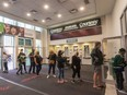 After getting their vaccine status checked outside, fans line up inside Budweiser Gardens on Oct. 1, 2021, for a preseason game between the London Knights and Hamilton Bulldogs. (Mike Hensen/The London Free Press)