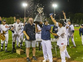 London Majors co-owners Scott Dart and Roop Chanderdat hold the Intercounty Baseball League championship trophy after the Majors defeated the Toronto Maple Leafs 8-4 in Game 5 Friday at Labatt Park. It was the team's first championship in 46 years and gives the Majors momentum heading into next season. Mike Hensen/The London Free Press