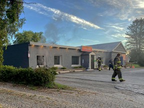 Smoke blows through the window of JJ's Country Diner on Sept. 28, after a fire destroyed the restaurant's office and smoke has damaged much of the inside of the business. (SUBMITTED PHOTO)