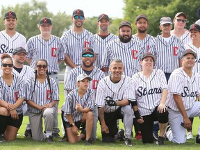 The descendants of the 1934 Chatham Colored All-Stars reunite for a group photo after playing a slow-pitch game at Rotary Park's Fergie Jenkins Field in Chatham on October 2.  Mark Malone / Postmedia Network