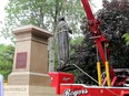 Work crews remove the statue of Sir John A Macdonald in City Park in Kingston on Friday June 18, 2021.
