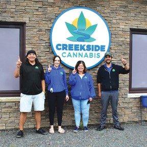 Photo by KEVIN McSHEFFREY/THE STANDARD Four staff members at Creekside Cannabis on Mississauga First Nation were out on Sept 25 celebrating one year in business.  They are: Tony Chiblow, Julia Horton, Tanya Bennett and Paul Corbiere. They feel they are number one.