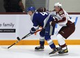 Peterborough Petes' Sam Alfano slows down Sudbury Wolves' Nathan Ribau during first period OHL action during the Petes home opener at the Memorial Centre on Thursday Oct. 14, 2021 in Peterborough, Ont.