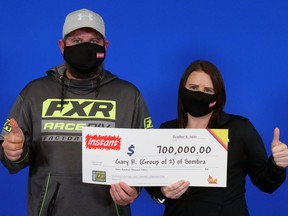 Gary Rankin and Ashley Bird of Sombra won $700,000, the top prize in a game called Instant Supreme 7, the Ontario Lottery and Gaming Corp. (OLG) said Wednesday. (OLG)