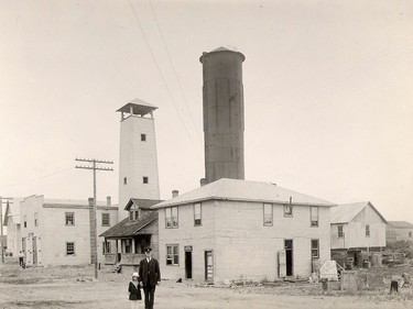 """The """"new"""" fire hall can be seen on the left of this photo, alongside the fire tower. Today that location is occupied by the parking lot at city hall. Chief Borland and a small friend are seen in the forefront.  Supplied/Timmins Museum"""