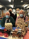 Claude Coderre and Gerry Desjardins, in the foreground, has applied their woodworking skills over the years to develop a number of exhibits on display at Science Timmins. On Satuirday, the workshop at Science timmins was renamed the Coderre-Desjardins Woodworking Shop. In the background are Science Timmins founders Antoine Garwah and Lorraine Cantin.  Supplied