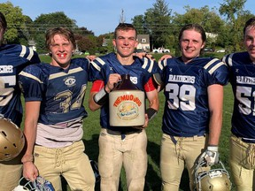 The Delhi Raiders defeated the Simcoe Sabres last week 19-0 at Simcoe Composite School in the teams' annual Mud Jug game. Among those savouring the win were, from left, Raiders Dylan VanSchalkwyk, Tre Hodder, Adam Leatherland, Nathan Dobbie, and Riley Brackenbury.  Monte Sonnenberg