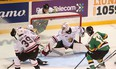 Luke Evangelista (14) tries to hide the puck from Attack goaltender Mack Guzda behind the net during a wraparound attempt in the first period as the Owen Sound Attack host the London Knights inside the Harry Lumley Bayshore Community Centre Saturday, October 9, 2021.