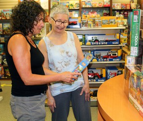 Sue Ortepi, left, and Gale Anthony check out a jigsaw puzzle at Creative Learning, Monday. Gale and her husband, Des, have owned the business since it opened 31 years ago, but have sold the business to a local resident. PJ Wilson/The Nugget