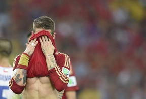 Spain defender Sergio Ramos reacts during a Group B match against Chile in the Maracana Stadium in Rio de Janeiro during the FIFA World Cup on Wednesday. With a 2-0 loss, Spain's hopes of retaining its World Cup title were ended.