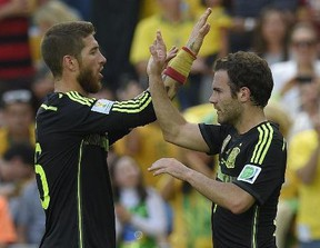 Spain's forward Juan Mata (R) and Spain's defender Sergio Ramos celebrate after Spain's forward Fernando Torres scored his team's second goal during a Group B match between Australia and Spain at the Baixada Arena in Curitiba during the 2014 FIFA World Cup on June 23, 2014.  LUIS GENE/AFP/Getty Images