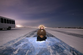 Jennifer Bain marvels at the night sky on the Yellowknife to Dettah ice road. Photo: North Star Adventures.