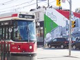 A High Park-bound streetcar passes through Little Italy
