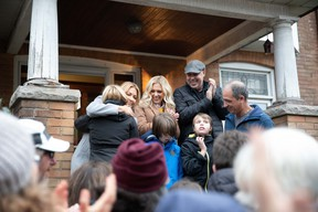 Back row (from left): Host Cheryl Hickey hugs homeowner Sarah, with designers Kortney Wilson and Dave Wilson standing by. Front row (from left): The homeowners' kids Hayden and Landon, and homeowner Kevin.