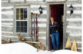 Artist Karen McBride's studio is in an old log cabin that she corralled family and friends to help disassemble, transport and reassemble at her Dunrobin horse farm.