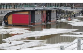 NCC skate shacks and vendor outlets that have yet to be removed from the Rideau Canal were spared any serious damage when the canal's water level rose suddenly after Parks Canada released water at the Hog's Back Lock on Wednesday.