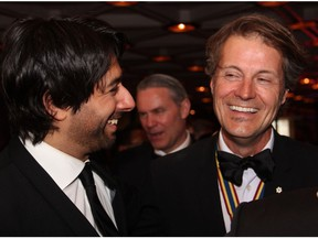 From left, Jian Ghomeshi shares a laugh with singer-songwriter Jim Cuddy of Blue Rodeo at the Governor General's Performing Arts Awards Gala held Saturday, May 10, 2014, at the National Arts Centre.