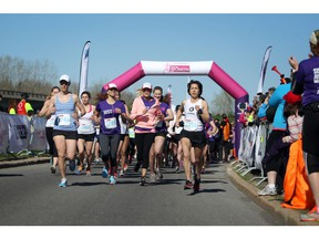 Mothers, daughters, and other family and friends take part in the Shoppers Drug Mart Run for Women on Sunday, May 11, 2014 near the Aviation Museum. The 5K. 10K, and 1k for children helps raise money for Women's Mental Health programs in race cities, such as Royal Ottawa.