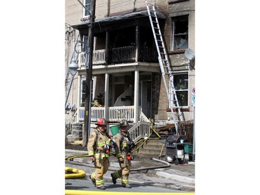 Ottawa firefighters respond to a blaze in an apartment building on Preston, Saturday, May 10, 2014.