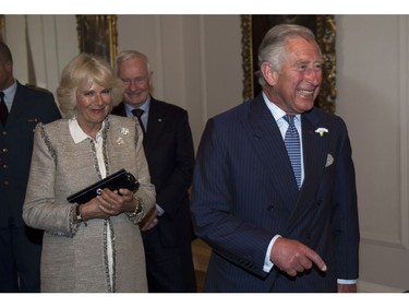 Prince Charles laughs after being sworn in as a member of the Privy Council as his wife Camilla and Governor General David Johnston look on in Halifax on Sunday, May 18, 2014. The Royal couple begin a four-day tour of Canada.