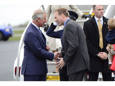 Prince Charles is greeted by Justice Minister Peter MacKay in Halifax Sunday, May 18, 2014. The Royal couple begin a four-day tour of Canada.