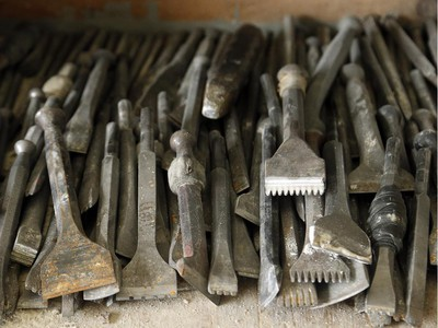A drawer full of chisels and other tools at the shop look like a throwback to another century. The ancient trade of stonemasonry is making a revival on Parliament Hill, and Danny Barber and John-Philippe Smith (founders of Smith and Barber stonemasons in Ottawa) are two of the mason/sculptors recreating the stone carvings there.