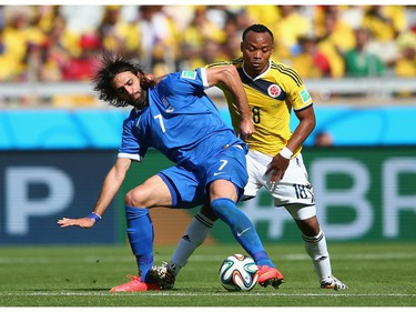 Giorgos Samaras of Greece fights off Juan Camilo Zuniga of Colombia during the 2014 FIFA World Cup Brazil Group C match between Colombia and Greece at Estadio Mineirao on June 14, 2014 in Belo Horizonte, Brazil.