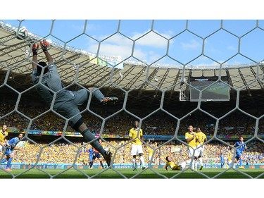 Colombia's goalkeeper David Ospina jumps for a ball during a Group C football match between Colombia and Greece at the Mineirao Arena in Belo Horizonte during the 2014 FIFA World Cup on June 14, 2014.