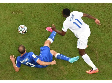 Italy's defender Giorgio Chiellini (L) and England's forward Daniel Welbeck vie for the ball during a Group D football match between England and Italy at the Amazonia Arena in Manaus during the 2014 FIFA World Cup on June 14, 2014.