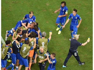Italy's national football team players celebrate after scoring during a Group D football match between England and Italy at the Amazonia Arena in Manaus during the 2014 FIFA World Cup on June 14, 2014.       POOL