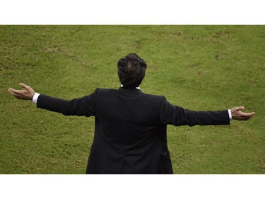 Italy's coach Cesare Prandelli gestures during a Group D football match between England and Italy at the Amazonia Arena in Manaus during the 2014 FIFA World Cup on June 14, 2014.