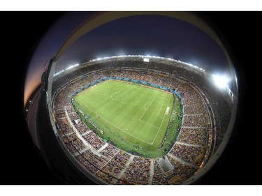 In this photo taken with a fisheye lens the teams run over the pitch during the group D World Cup soccer match between England and Italy at the Arena da Amazonia in Manaus, Brazil, Saturday, June 14, 2014.