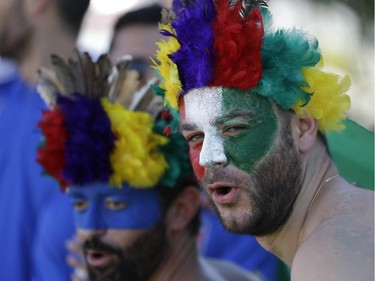 Italy fans stroll in downtown Manaus prior to the England vs Italy match during the 2014 soccer World Cup in Arena da Amazonia in Manaus, Brazil, Saturday, June 14, 2014.