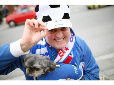 Nick Arnone and his dog Nove are dressed with country pride on Preston St. in Ottawa's Little Italy, during Italian Festival on Saturday, June 14, 2014.