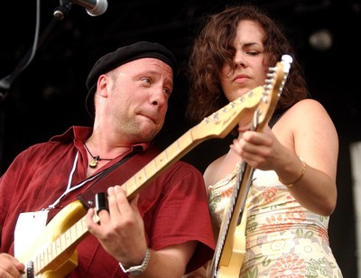 Tony D, left, shown with Roxanne Potvin, has become an annual tradition at Bluesfest, after saving the day once in the early years. (Photo by Kier Gilmour, Ottawa Citizen)
