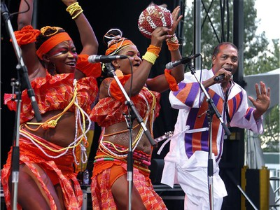 Femi Kuti plays with his band at opening night of RBC Bluesfest 2013 in Lebreton Flats Thursday.