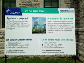 An example of new development street signs announced Monday that use plainer language and images of proposals when applicable.