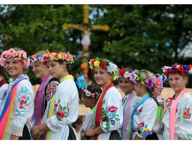 Young women in traditional dress take part in an international potters festival in the Belarusian village of Gorodnaya, some 360 km south-west of Minsk, on July 27, 2014. The village is famous for its potters.
