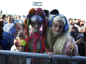 Fans like Courtney Constable (left) and Sarah Skaare lined up to be in the front row for the Lady Gaga concert at RBC Ottawa Bluesfest in Ottawa, July 5, 2014.