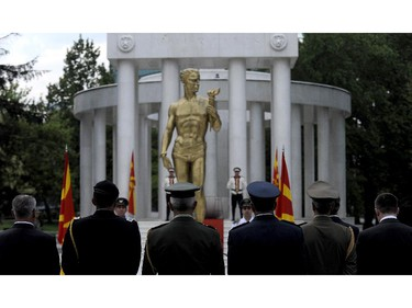 Foreign military representatives attend a commemorative ceremony at the fallen heroes memorial in Skopje, Macedonia, on Sunday, July 27, 2014, to mark the 100th anniversary of the beginning of World War I.