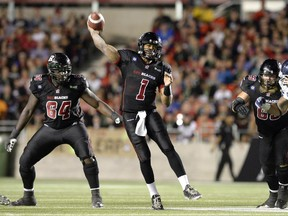 Ottawa Redblacks Henry Burris (1) passes the ball as the Redblacks took on the Toronto Argonauts during the second half of CFL action at TD Place in Ottawa on Friday, July 18, 2014. The Redblacks beat the Argonauts 18-17 in their first home game.