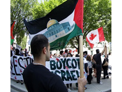 Hundreds of people rally in support of Palestine at the Human Rights Memorial in Ottawa, Saturday, July 12, 2014. Many brought banners and flags, and chanted, and later, they marched toward another rally in front of the US embassy on Sussex Dr.