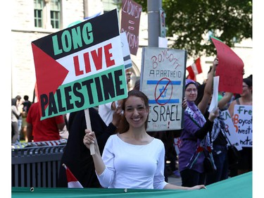 Hundreds rally in support of Palestine at the Human Rights Memorial in Ottawa, Saturday, July 12, 2014. Many brought banners and flags, and chanted, and later, they marched toward another rally in front of the US embassy on Sussex Dr.