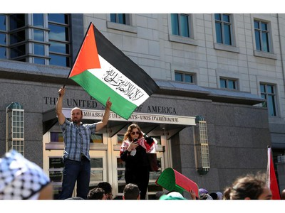 Hundreds rally in support of Palestine outside the US embassy in Ottawa, Saturday, July 12, 2014. Many brought banners and flags, in a protest march that began at 2pm at the Human Rights Memorial on Elgin St.